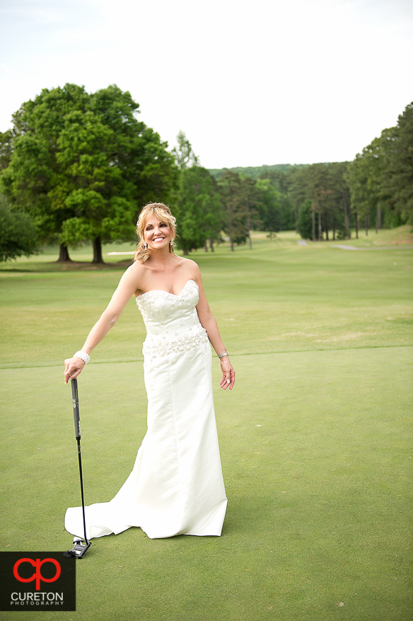 Bride on tehgolf course at Spartanburg Country Club.