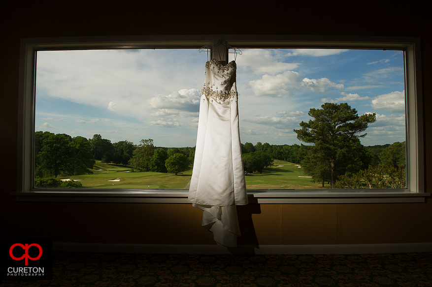 Wedding dress with the golf course in the background.