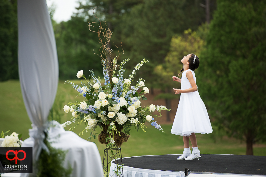 Flower girl looking at the sky before the wedding.