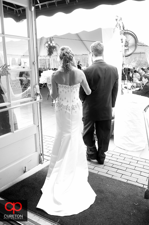 Bride escorted down the aisle by her son.