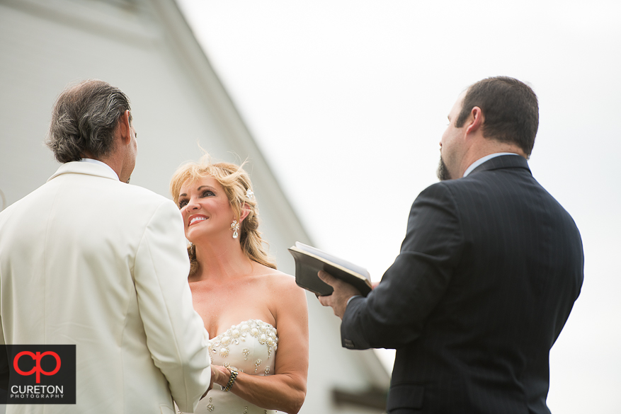 Bride looking at her groom during the ceremony.