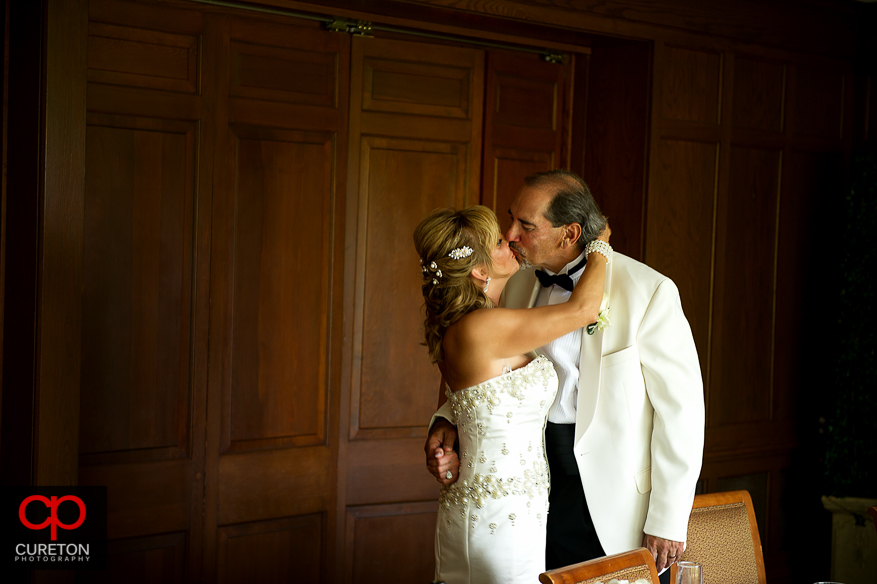 Newlyweds kissing after the ceremony.