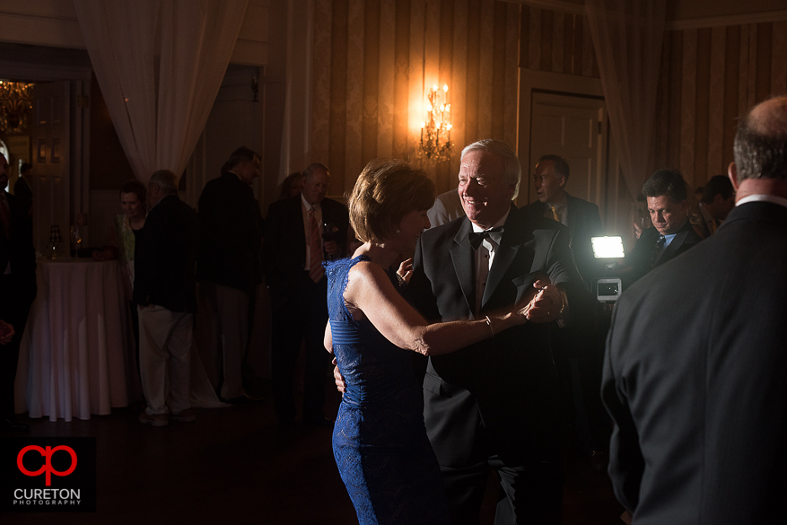 Wedding guests dancing at the reception at the country club.