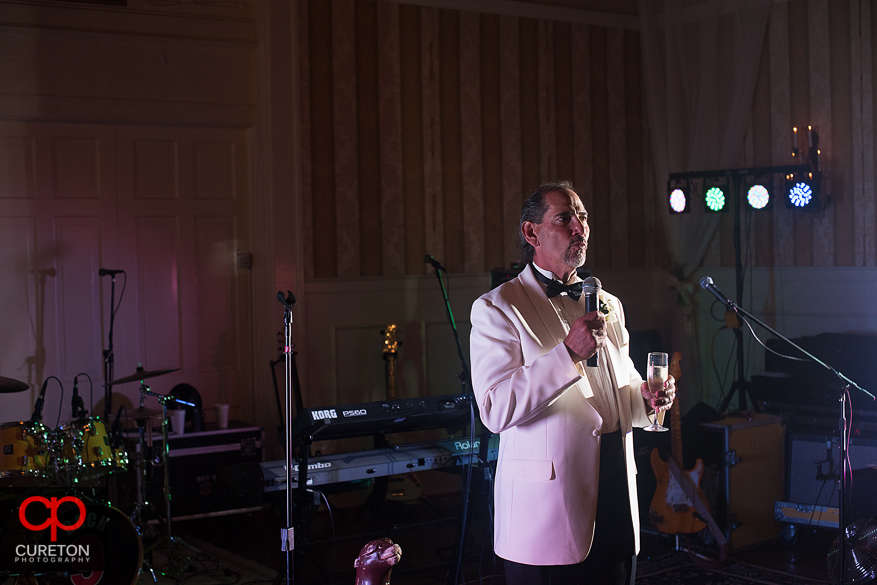 Groom giving a toast.