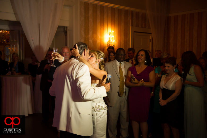 Bire and groom kissing at their reception.