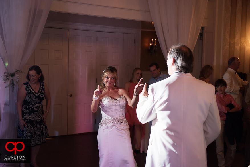 Bride dancing having a good time.