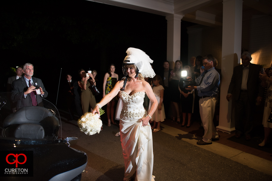 Bride tosses her bouquets as they are leaving.