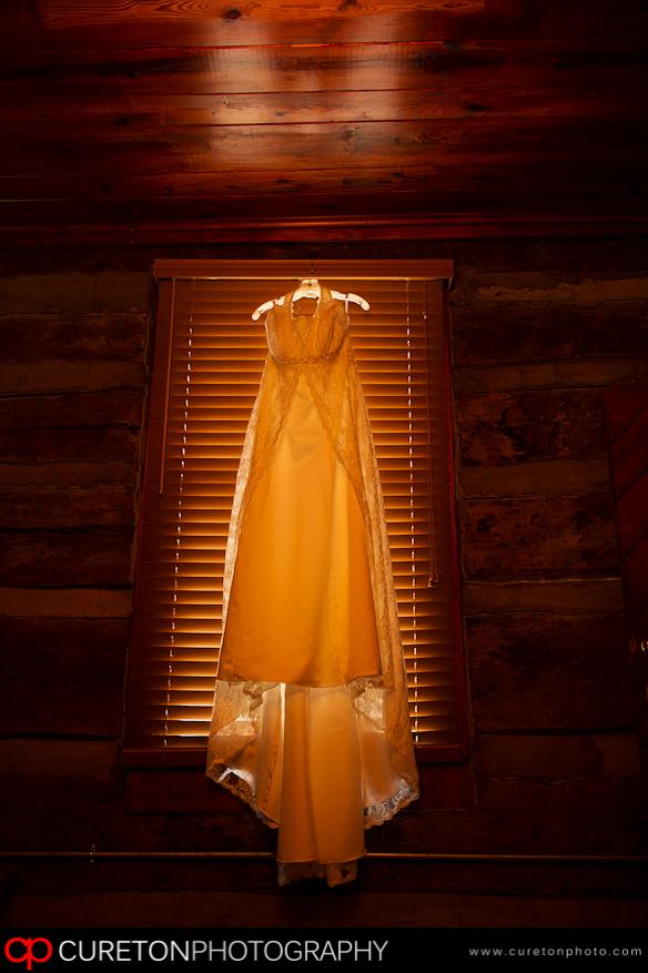 Brides dress hanging up.