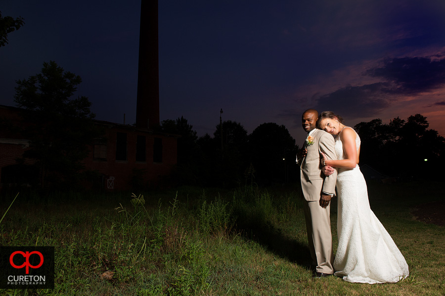 Newly married couple outside their wedding at The Loom in Simpsonville,SC.