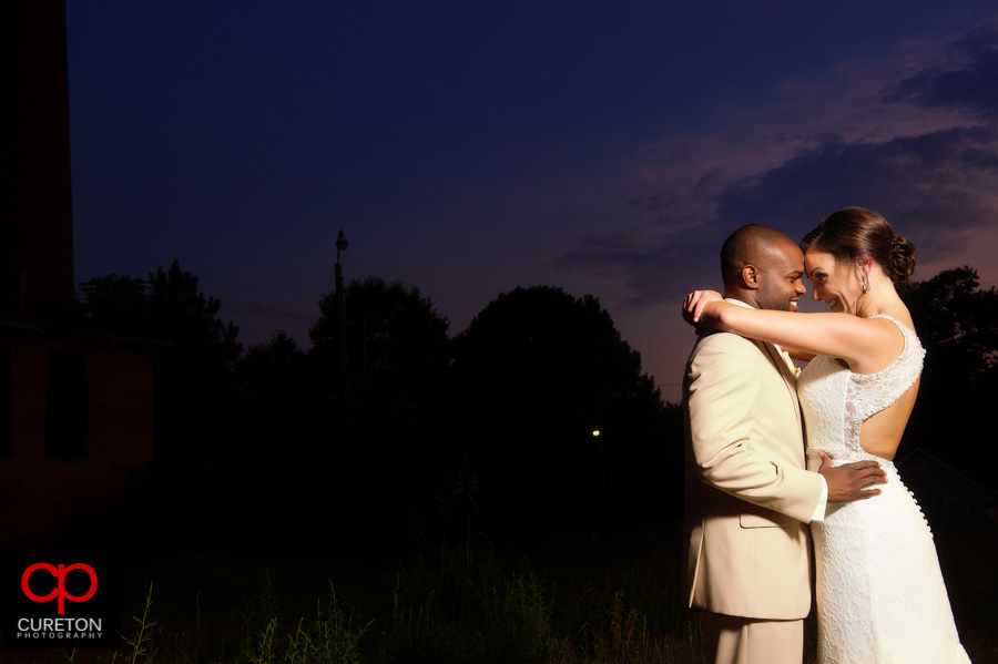 Brode and groom at sunset at The Loom in Simpsonville,SC.