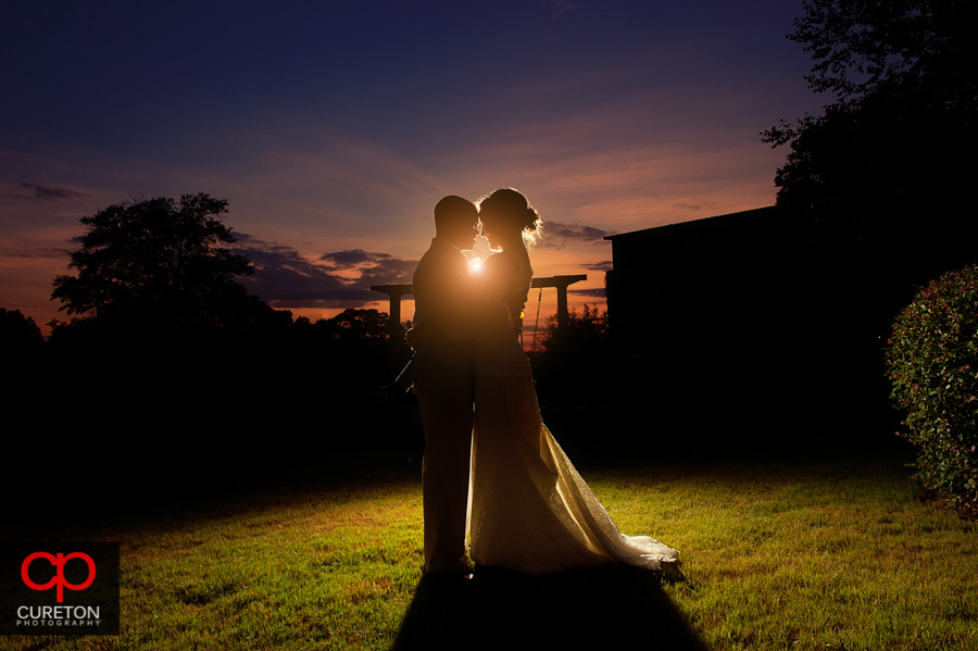 Bride and Groom behind the old million Simpsonville,SC.