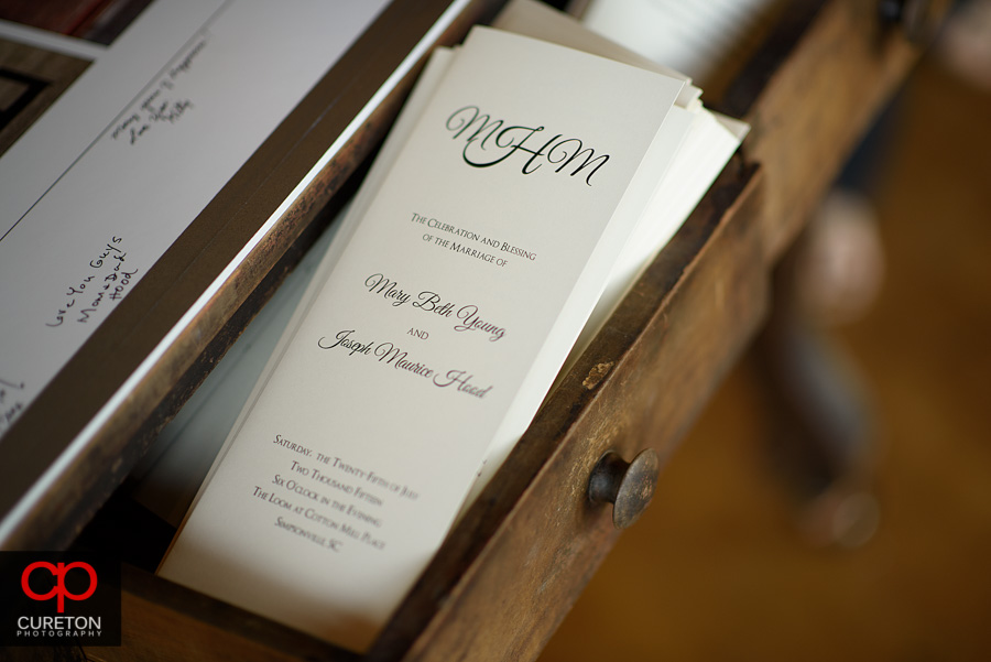 The wedding programs in a drawer.