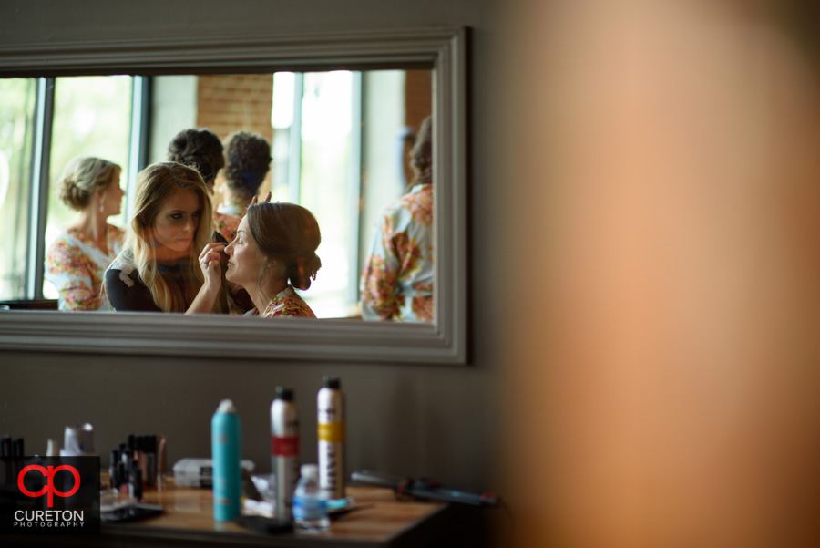 The girls from Bloom salon in Spartanburg applying bridal makeup.