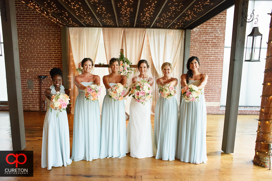 The bridesmaids at the alter before the wedding.