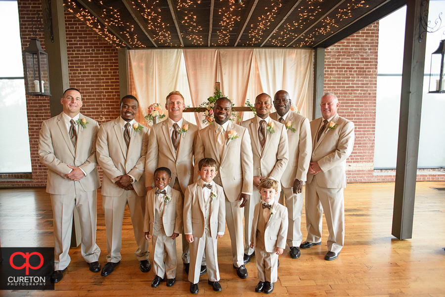 The groomsmen at the alter before the wedding.