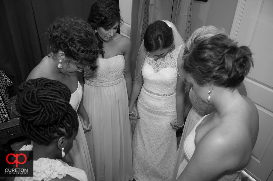 The bride praying pre-wedding.