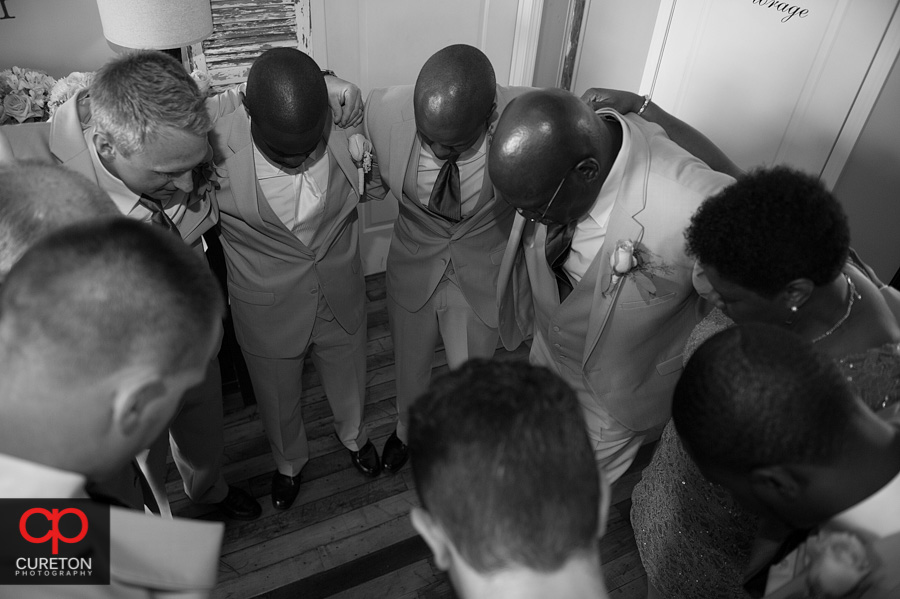 The groom praying before the wedding.