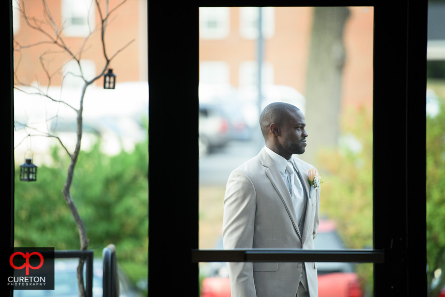 Groom standing outside ready to enter the wedding.