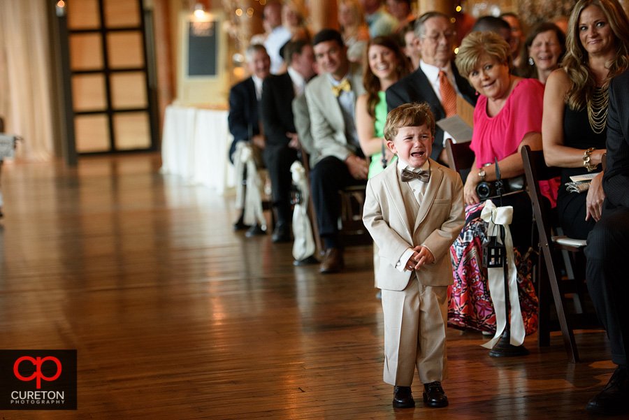 Ring bearer cries going down the aisle.