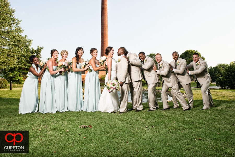 Creative wedding party posing at The Loom in Simpsonville,SC.