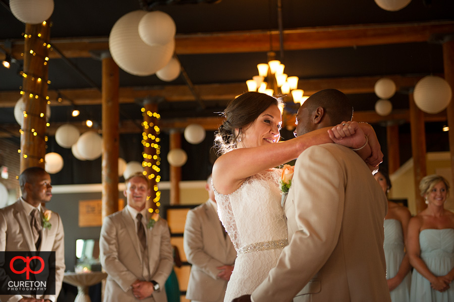 Bride looks at the groom during their first dance.