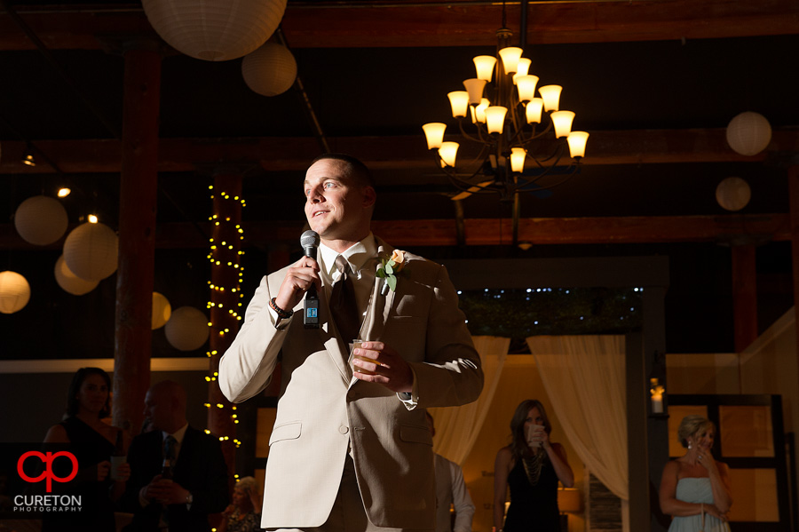 The groom's brother giving a toast.