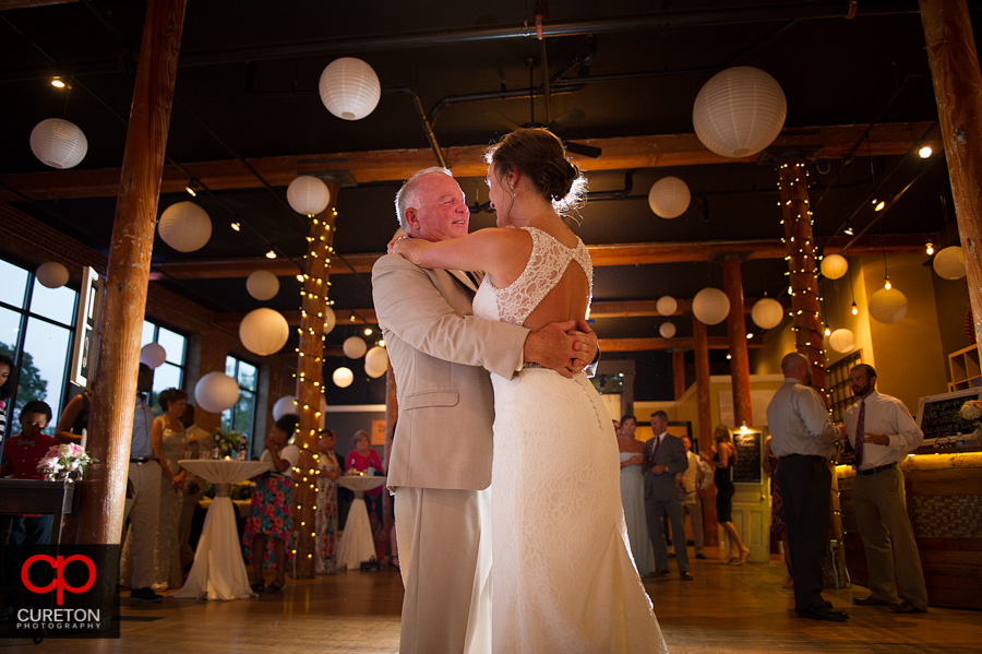 The bride and her father dancing.