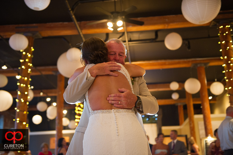 Bride hugging her father.