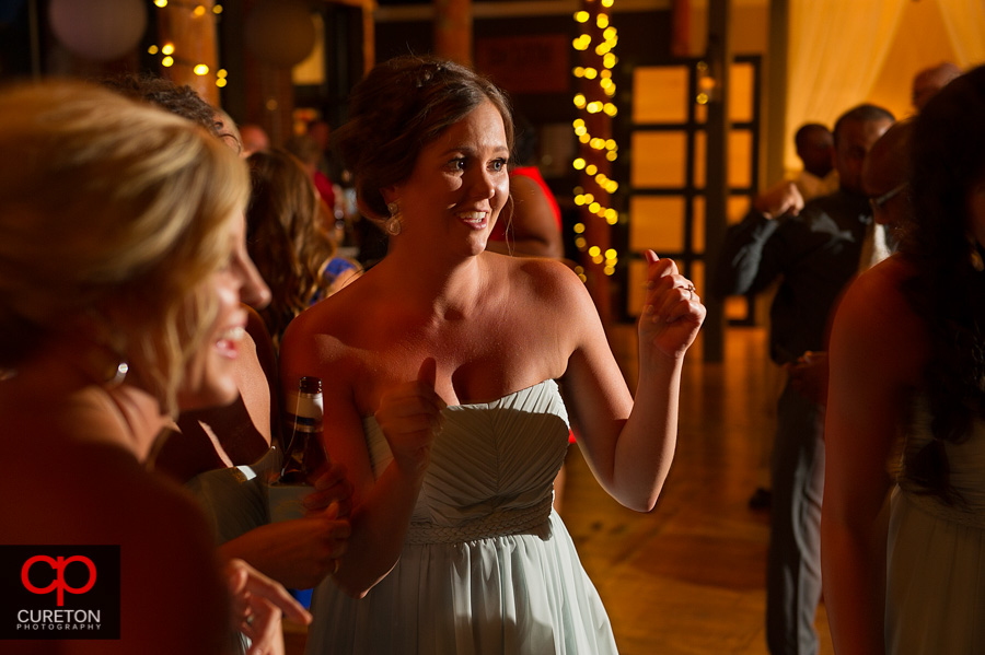 Guests dancing at the wedding reception at The Loom in Simpsonville,SC.