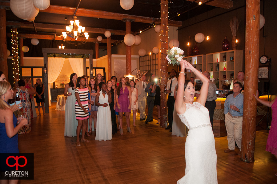Bride tossing the bouquet.