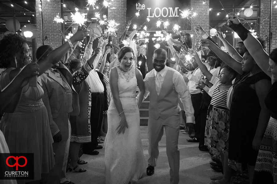 Bride and groom leaving their reception.