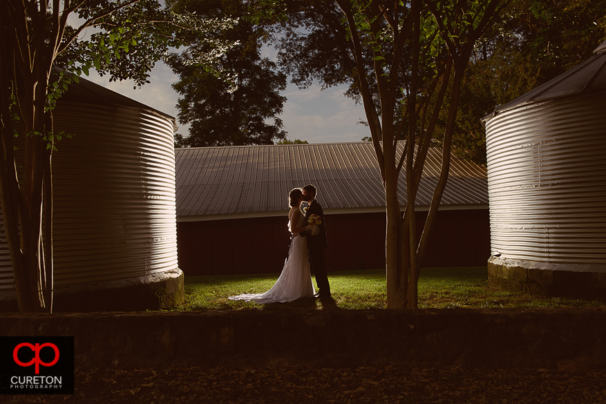 Gorgeous creative picture of the bride and groom after their Timberock at Hopkins Farm wedding in Simpsonville,SC.