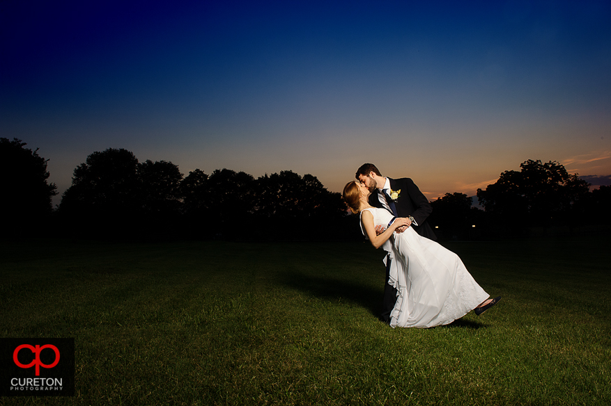Married couple dancing at sunset in Simpsonville , South Carolina.
