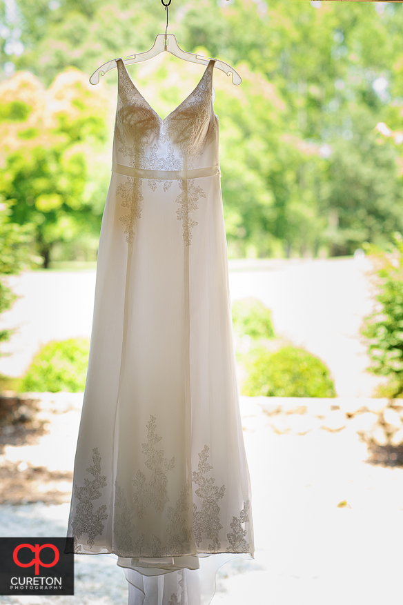 Close-up of the brides dress hanging.