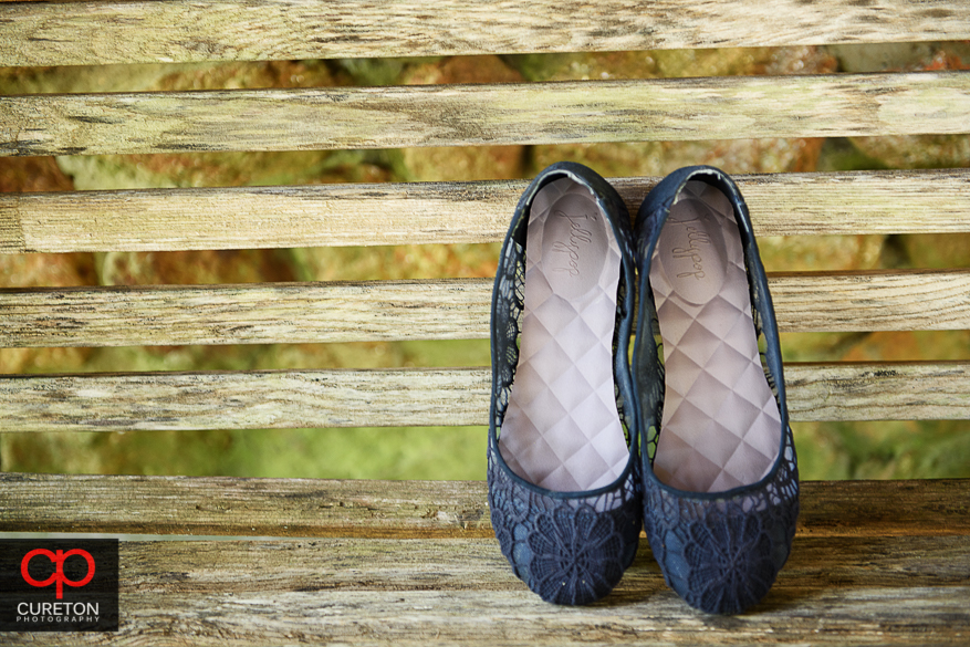 The bride's shoes leaned up against a rustic bench at the farm.