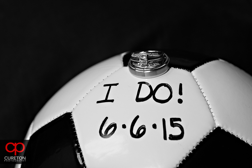 The wedding rings placed atop a soccer ball.