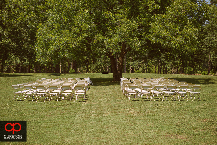 The chair set up under the tree before the wedding.