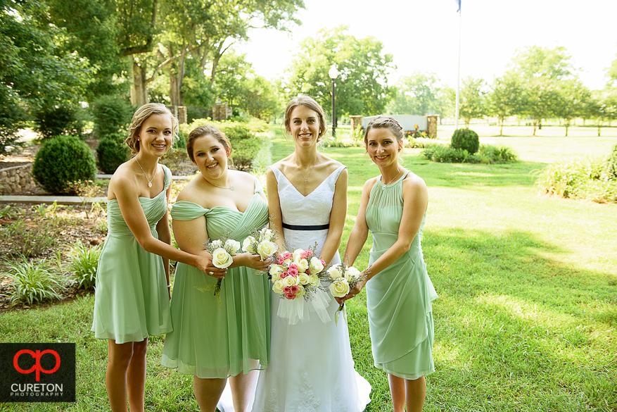 Bridesmaids posing at Timberock at Hopkins Farm .