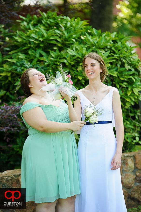 Bride and a bridesmaid having fun.