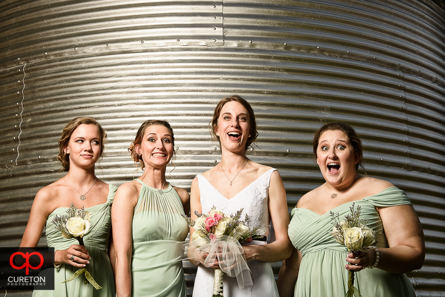 The bride and the bridesmaids having fun.