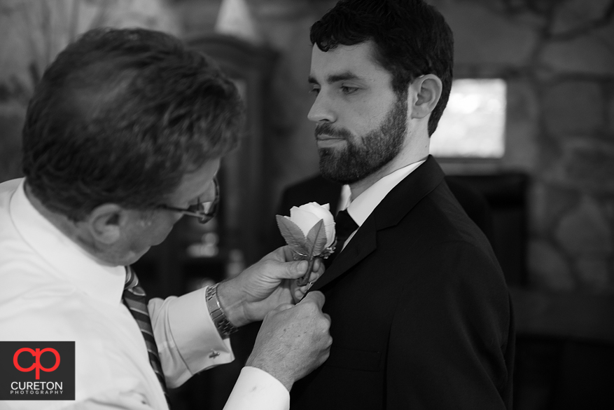 The groom gets his flower on.