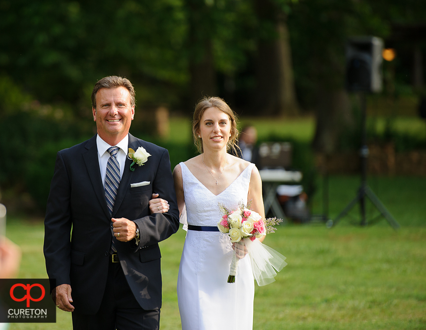 The bride and her father walking down the aisle.