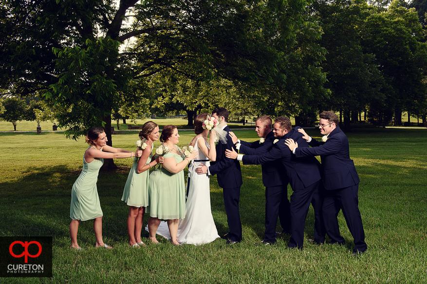 Creative farm wedding party photo.