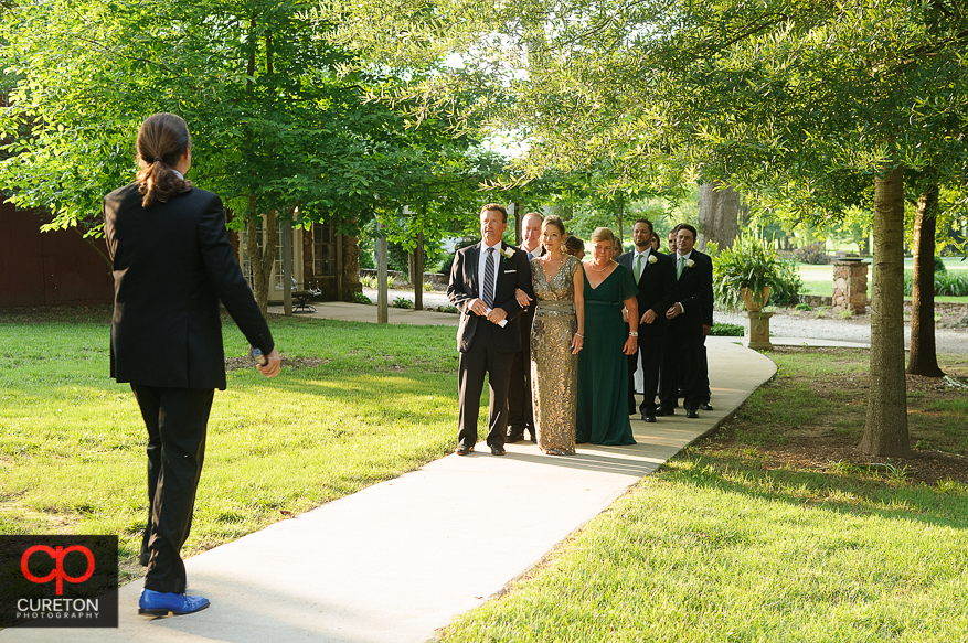 The wedding party is introduced.
