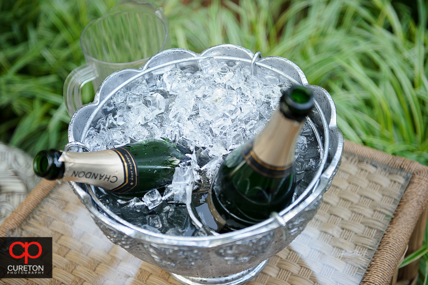 Two bottles of champagne on ice.