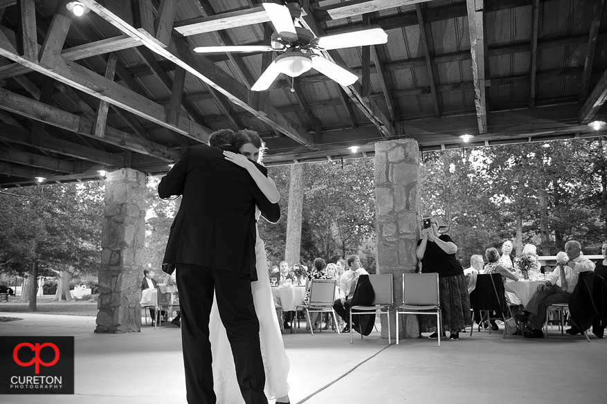 The bride and her father dance.