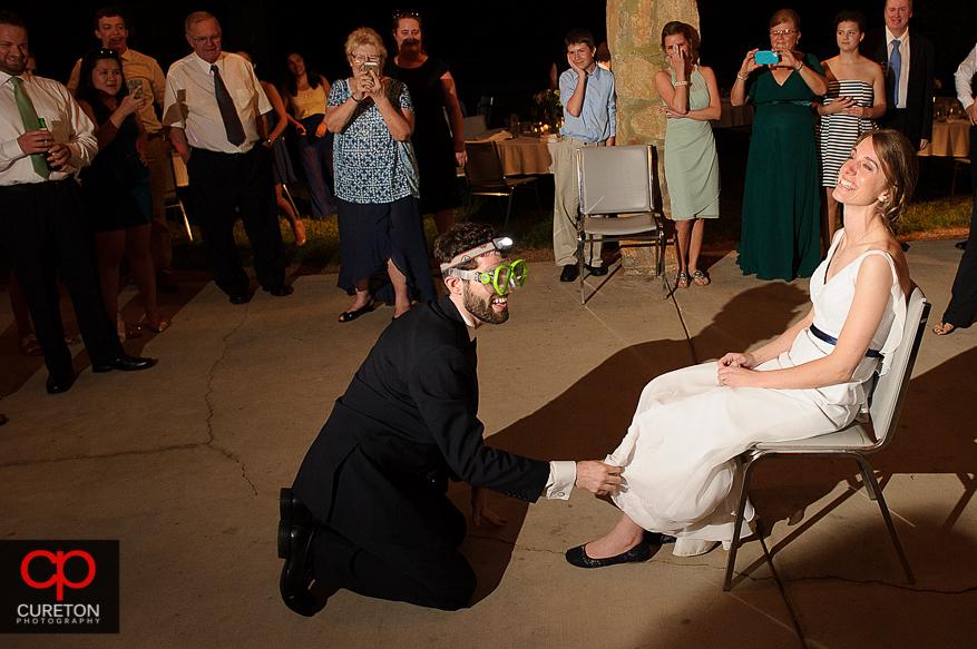The groom taking off the garter.
