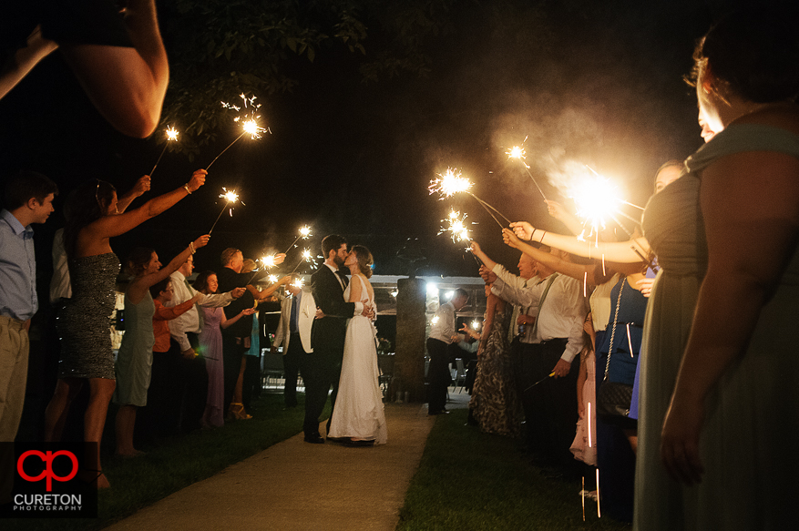 The bride and groom leave under sparklers at Hopkins Farm.