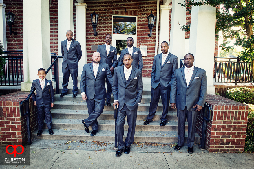Groom and groomsmen on the steps of the Upcountry History Museum.