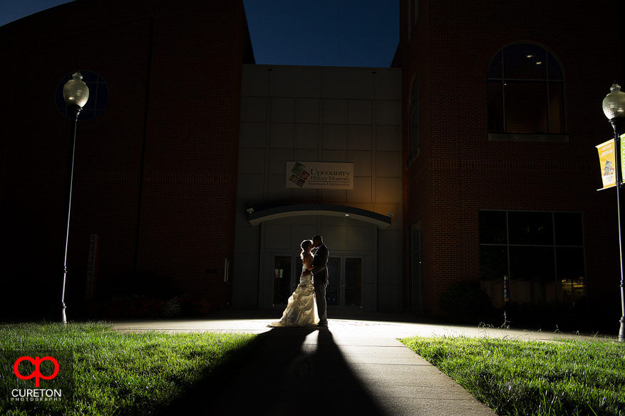 Couple backlit in front of Upcountry History Museum in Greenville,SC.